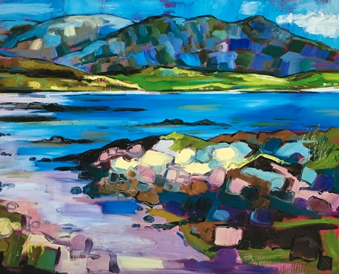 Blue water, sky and hills with green and purple abstract rocks to fore